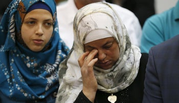 The mother of murdered Palestinian teen Mohammed Abu Khedeir reacts in court as the guilty verdict of one of his killers is announced in court on April 19, 2016.
