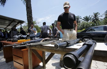 A French security guard looks at arms at Agban gendarmerie camp in Abidjan, Ivory Coast, March 15, 2016.