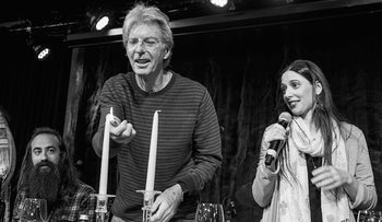Phil Lesh lights the candles as cantorial soloist Jeannette Ferber sings the blessing and guitarist Ross James looks on.