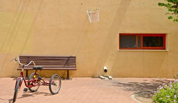 A tricycle in the courtyard of the Beit Safra hostel in Carmiel, April 21, 2016.