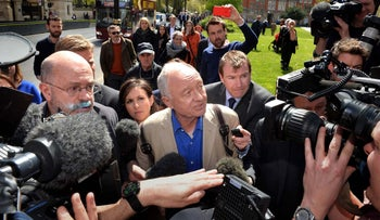 Former mayor of London Ken Livingstone (center) is surrounded by media in London on April 28, 2016.