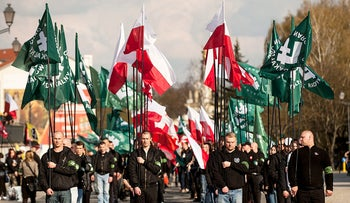 Extreme-right National Radical Camp members march to mark the organization's 82nd anniversary, founded on fascist ideas and promoted antisemitism before World War II, Bialystok, Poland, April 16, 2016.
