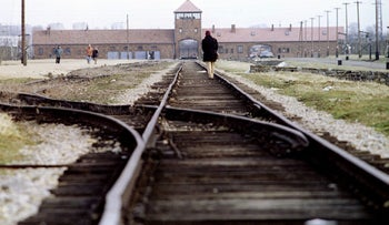 Visitors at the main gate of Auschwitz-Birkenau, January 25, 1995.
