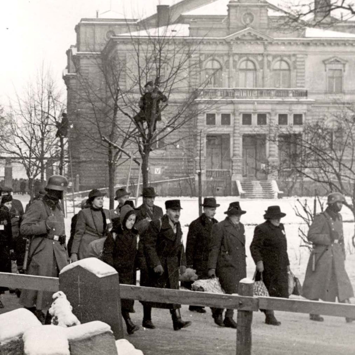 Jews being marched to a train in Pilsen, Czechoslovakia, 1942.