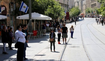 People stand still as a two-minute siren marking Holocaust Remembrance Day is sounded in Jerusalem, May 5, 2016.