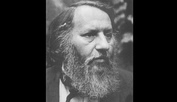 Avram Davidson,around 1970. Shown with flatly combed hair and bushy, full beard, untied tie and open-necked button shirt.