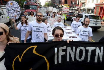 Members of IfNotNow march through the streets of Washington, D.C., April 19, 2016.