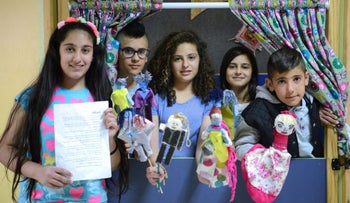 Buqata students with their gender-reversed Cinderella puppets.