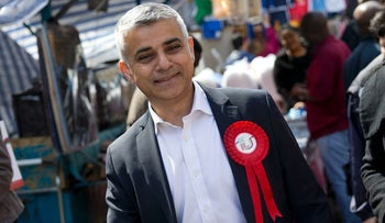 Britain's Labour party candidate for London Mayor Sadiq Khan reacts as he canvasses for supporters at a market in London on May 4, 2016.