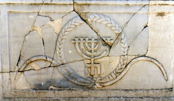 Fourth century Menorah in Rehov stands on three legs, not a base.