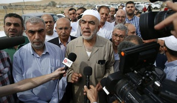 Arab-Israeli Sheikh Raed Salah (C), the leader of the radical northern wing of the Islamic Movement in Israel, answers journalists' questions as he arrives at the Eshel prison in the southern Israeli city of Beer Sheba to begin a nine-month prison sentence for incitement to violence, on May 8, 2016.