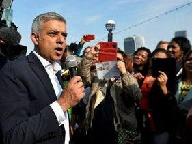 Britain's newly elected mayor Sadiq Khan speaks to supporters as he arrives for his first day at work at City Hall in London, Britain May 9, 2016.