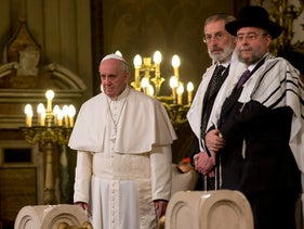 Pope Francis, flanked by Rabbi Riccardo Di Segni, makes his first visit to a synagogue at the Great Synagogue of Rome, January 17, 2016.