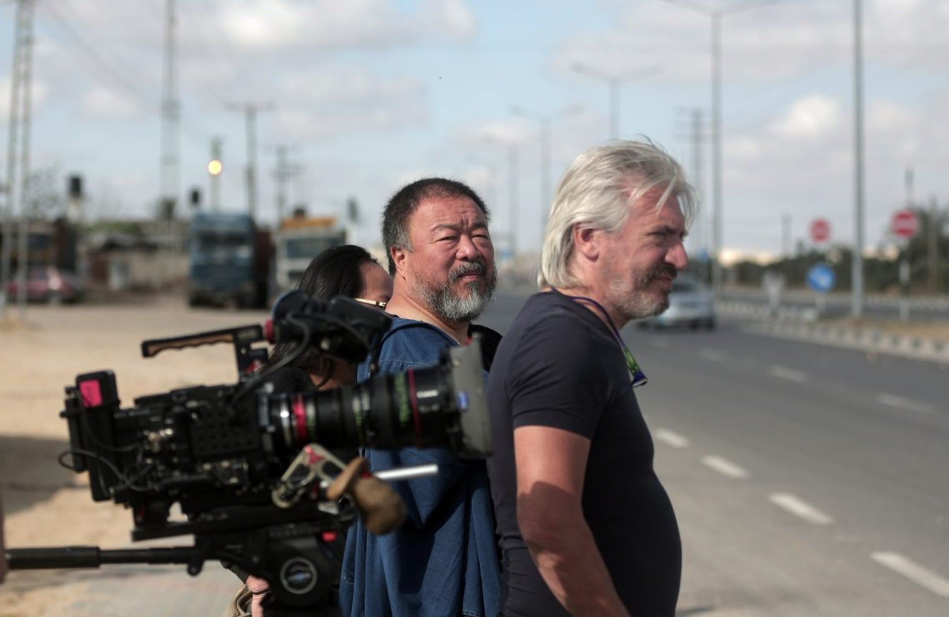 Chinese artist and activist Ai Weiwei, center, filming a documentary on refugees at Gaza's Rafah crossing with Egypt, May 11, 2016.