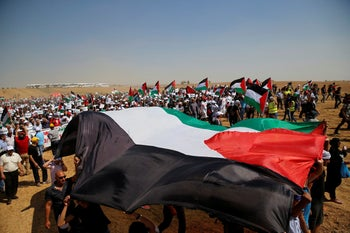 Arab Israeli protesters march to commemorate Nakba Day, Rahat, Israel, May 12, 2016.