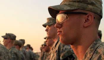 U.S. Army soldiers stand in formation during a ceremony in Camp Virginia, Kuwait, Aug. 21, 2010.