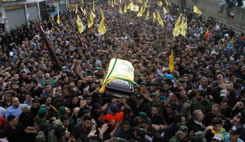 Members of Hezbollah carry the coffin of Mustafa Badreddine, a top commander killed in Syria, during his funeral in Beirut, May 13, 2016.