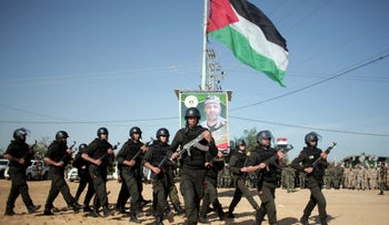 Palestinian Hamas security forces deploy on the Palestinian side of the border with Egypt in Rafah, southern Gaza Strip, Thursday, April 21, 2016.