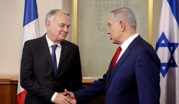Netanyahu shakes hands with French Foreign Minister Jean-Marc Ayrault at the Prime Minister's office in Jerusalem, May 15, 2016.