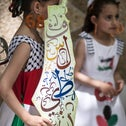 A Palestinian girl wears earrings bearing the number '68' on May 15, 2016 in Gaza city during a rally to commemorate the 'Nakba.'