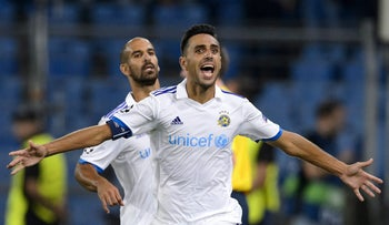 Tel Aviv's midfielder Eran Zahavi celebrates with Gal Alberman after scoring second goal during UEFA Champions League playoff against FC Basel, Basel, Germany, Aug. 19, 2015.