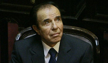 Argentina's former President Carlos Menem attends his swearing-in ceremony as senator for La Rioja province at the National Congress, Buenos Aires, Argentina, November 29, 2005.