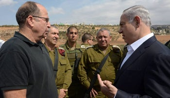 Netanyahu, Ya'alon and Eisenkot at a tour of the West Bank, 2015.