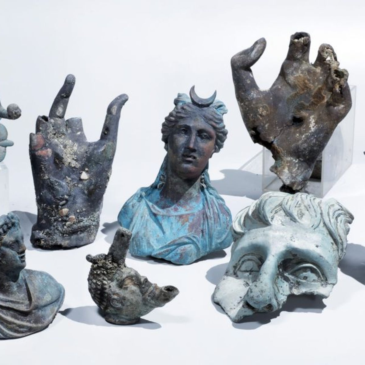 Bronze artifacts found by amateur divers off the coast of Caesarea in May, 2016, belonging to a Roman ship that sunk there some 1,600 years ago.