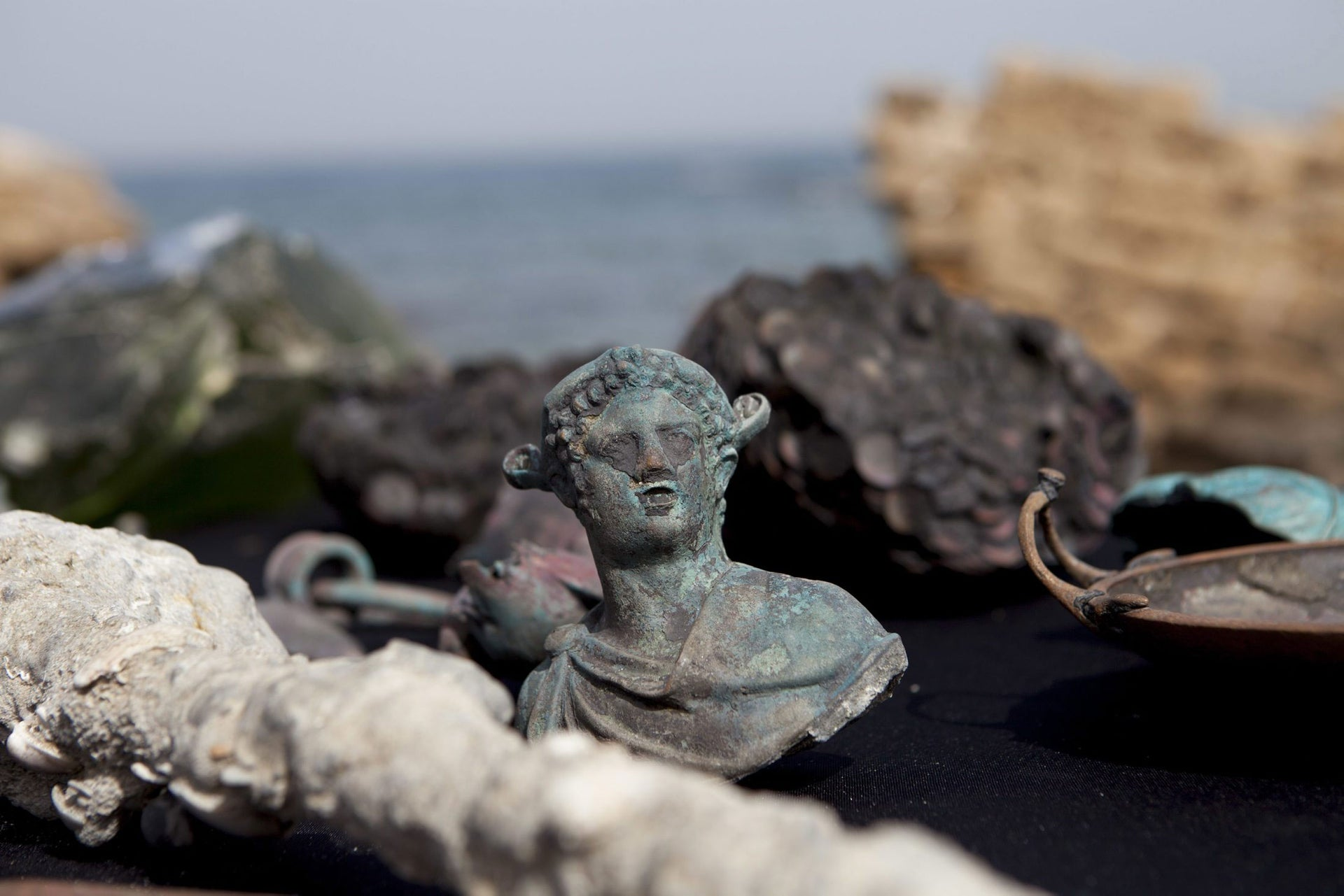 Rare bronze artifacts, part of a large ancient marine cargo of a merchant ship that sank during the Late Roman period 1,600 years ago seen during a presentation of the Israel Antiquities Authority in Caesarea, Israel. Monday, May 16, 2016.