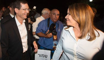Isaac Herzog and Shelly Yacimovich of the Labor Party, in Tel Aviv in April, 2016.