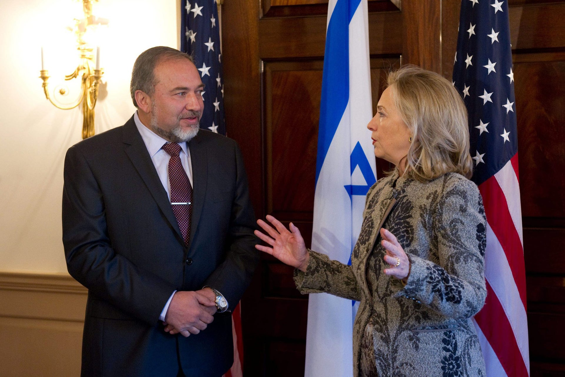 Hillary Clinton, then U.S. secretary of state, talks with Avigdor Lieberman, Israel's foreign minister at the time, in Washington, on Feb 7, 2012.