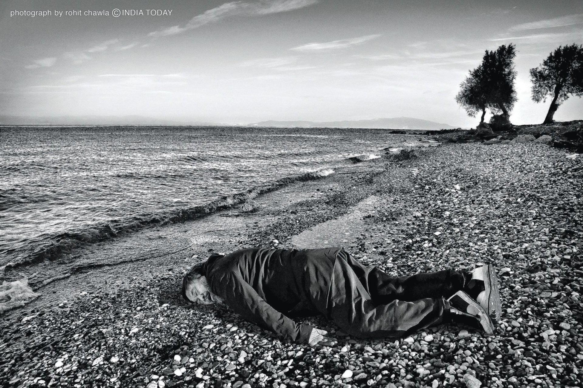 Artist Ai Weiwei poses in Lesbos, Greece, in the position of Syrian refugee child Aylan Kurdi, who died there in September 2015.