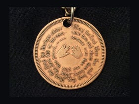 Left and right hands coming together for a priestly blessing, in English. Medallion, mid-20th century, New York.