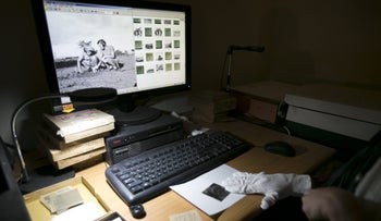 Documents from the State Archives being digitized.
