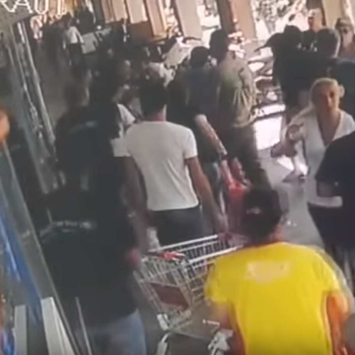 A screenshot from a surveillance camera video showing police beating an Arab employee outside a Tel Aviv supermarket, May 22, 2016.
