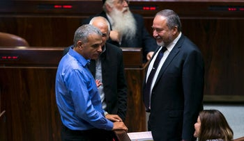 Treasury Minister Moshe Kahlon, left, with Avigdor Lieberman of Yisrael Beiteinu, in the Knesset in 2015.