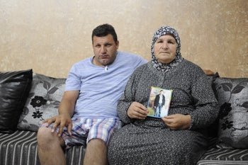 The mother and brother of Khair Khalila, who was killed after falling at a construction site in November 2013, May 23, 2016.