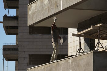 A construction worker at a building site in Ashkelon, November 25, 2014.