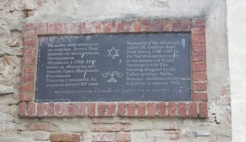 A plaque identifies the remnants of the former Golden Rose Synagogue in Lviv, Ukraine.
