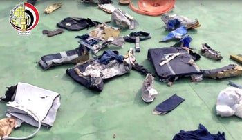Still image taken from video posted Saturday, May 21, 2016, on the official Facebook page of the Egyptian Armed Forces spokesman shows some personal belongings and other wreckage from EgyptAir flight 804 in Egypt.
