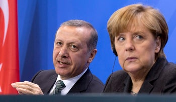 German Chancellor Angela Merkel listens as Turkey's Prime Minister Recep Tayyip Erdogan speaks during a joint press conference, Berlin, Germany, February 4, 2016.