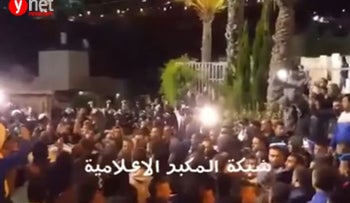 The crowd at the funeral of Alaa Abu Jamal on Monday night.