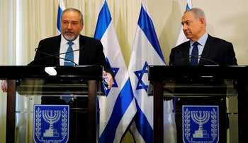 Avigdor Lieberman, head of far-right Yisrael Beitenu party, (L) and Israeli Prime Minister Benjamin Netanyahu deliver statements to the media after signing a coalition deal to broaden the government's parliamentary majority, at the Knesset, the Israeli parliament in Jerusalem May 25, 2016. REUTERS/Ammar Awad