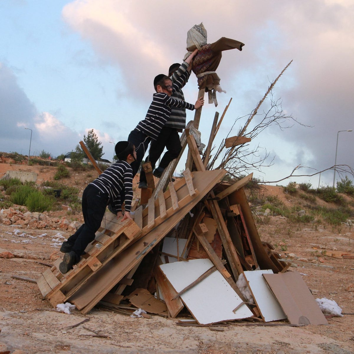 Ultra-Orthodox Jewish children build a bonfire, one day ahead celebrations of Lag BaOmer, in Beitar Illit on May 24, 2016.