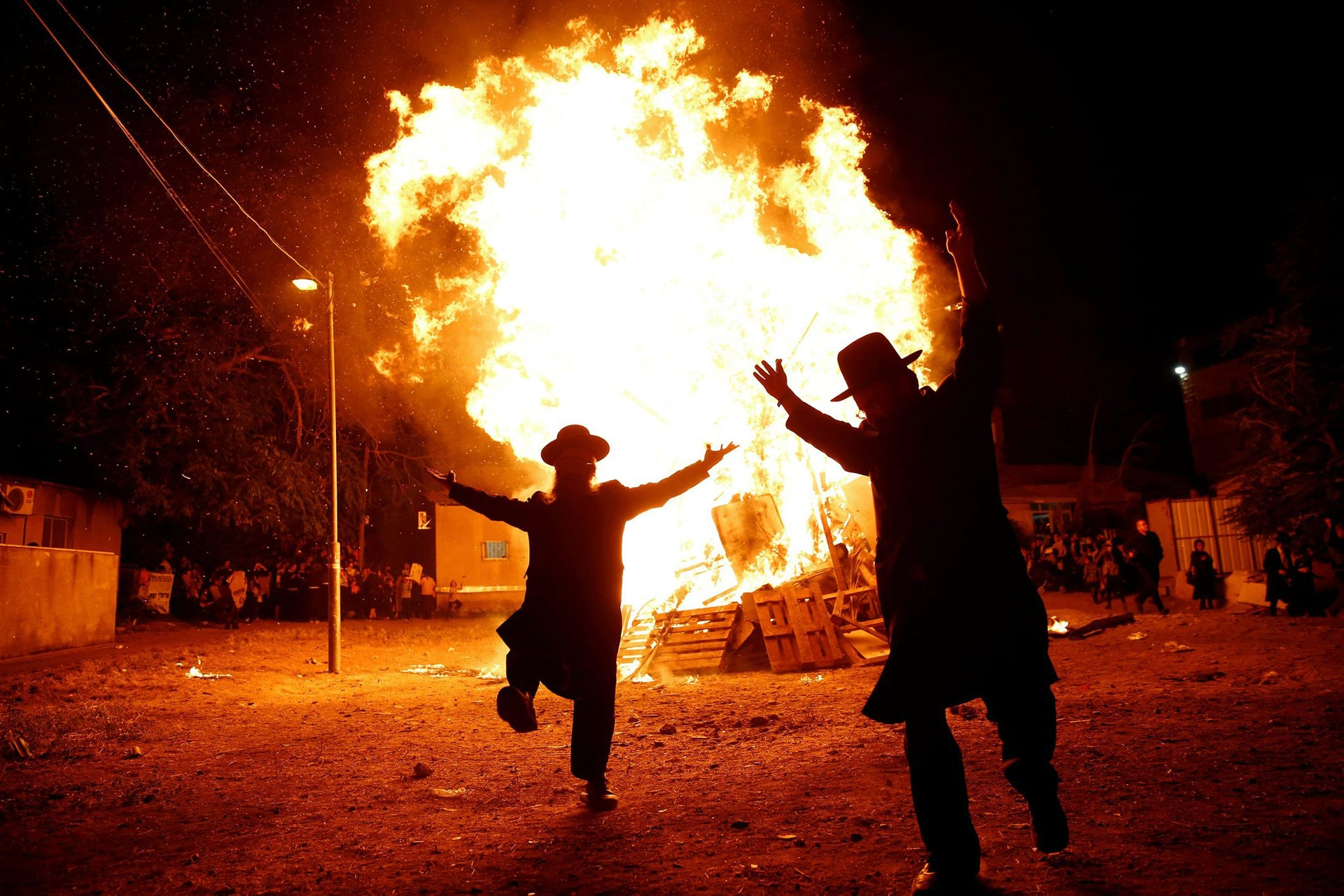 Ultra-Orthodox Jews dance next to a bonfire during celebrations for the Jewish holiday of Lag Ba'omer in Jerusalem's Mea Shearim neighborhood May 25, 2016.