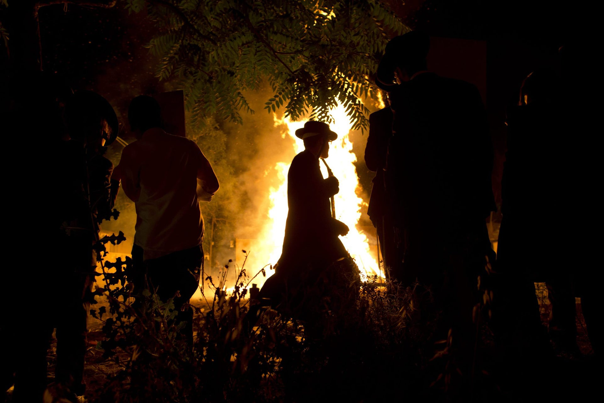 Ultra-Orthodox Jews stand around a bonfire during the Jewish holiday of Lag Ba'Omer celebration in Jerusalem, Wednesday, May 25, 2016. The holiday marking the end of a plague said to have decimated Jews during the Roman times.