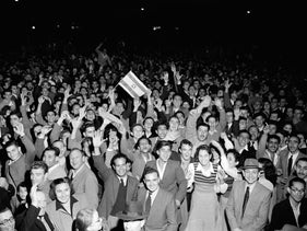 A celebration in Tel Aviv after the UN declares plans for the partition of Israel and Palestine, November 30,1947.
