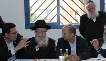 Health Minister Yaakov Litzman and Education Minister Naftali Bennett at a meeting in Arad.