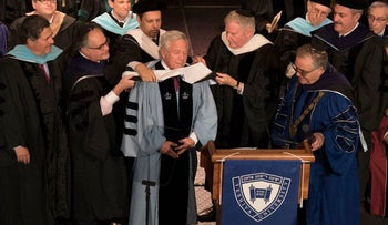 "Robert Kraft being ""hooded"" at the Yeshiva University commencement in New York City, May 26, 2016."