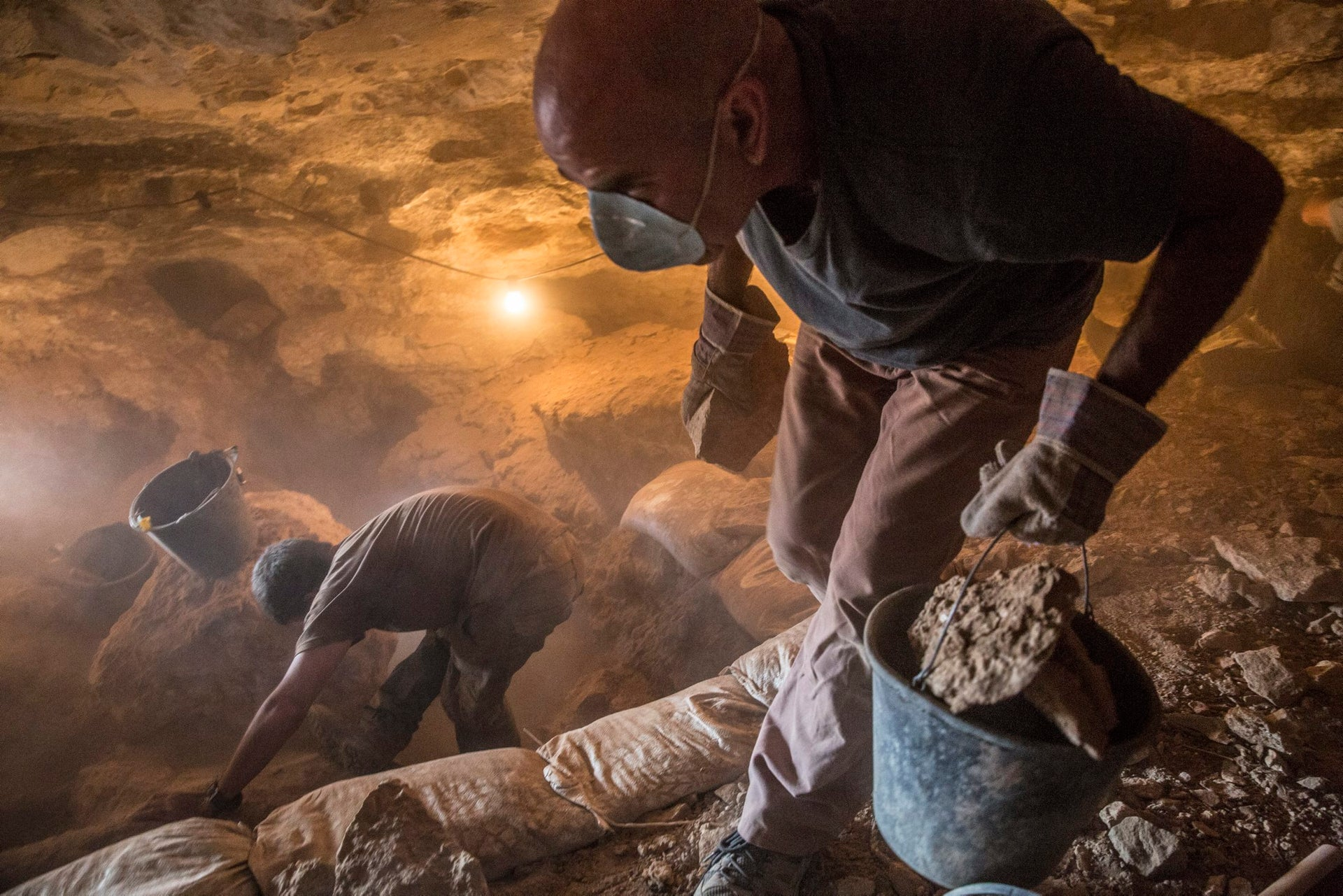 DUST TO DUST: Some 25 diggers are working in the cave at any one time.